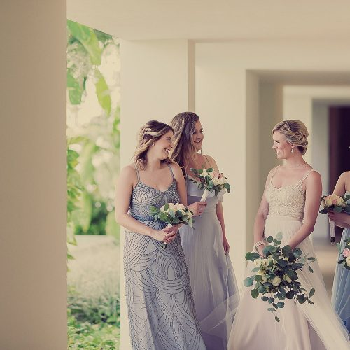 Bride with bridesmaids talking