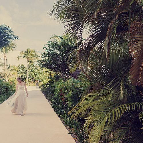 Bride walking down sidewalk at Finest Playa Mujeres resort