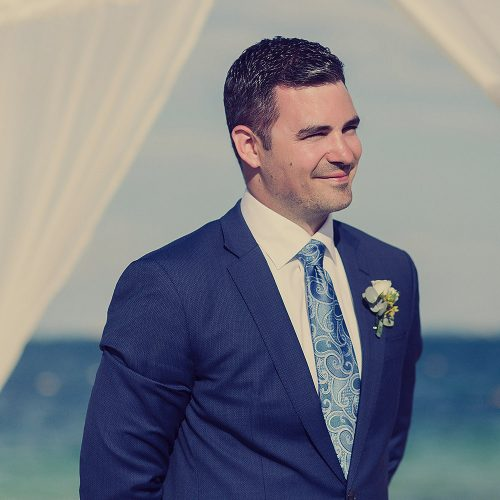 Groom seeing bride for first time walking down aisle.