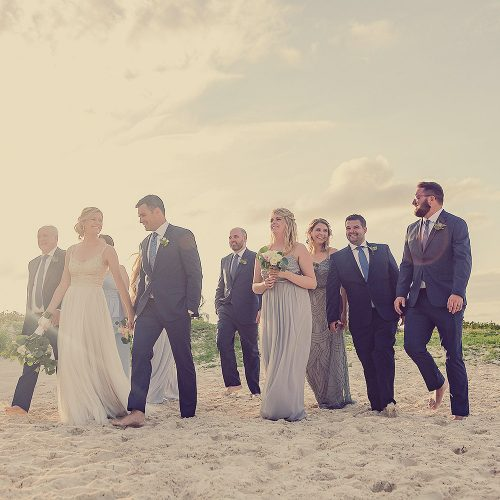 Bridal party walking on beach at Finest Playa Mujeres wedding