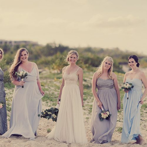 Portrait of bridesmaids on beach.