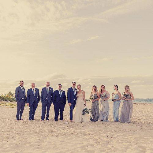 Bridal party on beach.