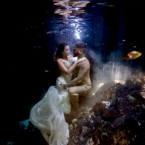 Bride and Groom underwater in Cenote Trash the Dress in Mexico