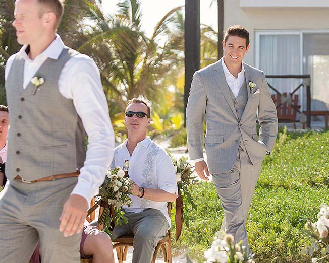 Groom walking down Aisle in Tulum on beach