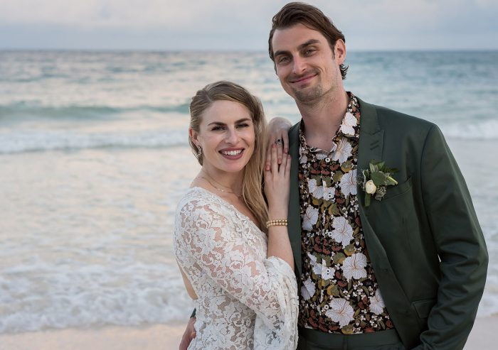 Bride and groom on beach with patterned shirt