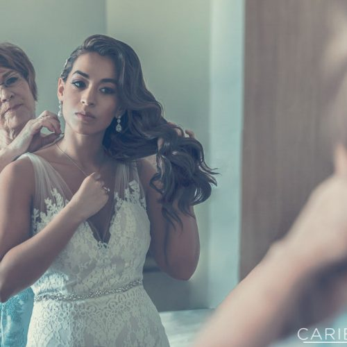 Bride getting ready with mother at The Finest Playa Mujeres resort
