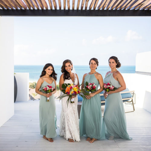 Bride and bridesmaids on rooftop deck at Finest Playa Mujeres