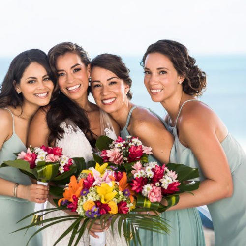 Close up of bride with bridesmaids.