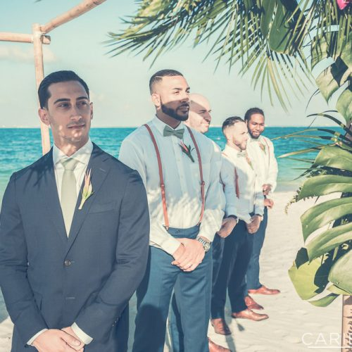 Groom waiting for bride at ceremony at The Finest Playa Mujeres resort