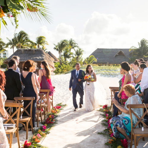 Bride walking down aisle at beach wedding at Finest Playa Mujeres