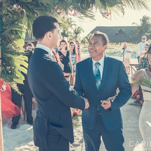 Groom shaking the father of the bride after he walks bride down the isle at Finest Playa Mujeres, Cancun Mexico