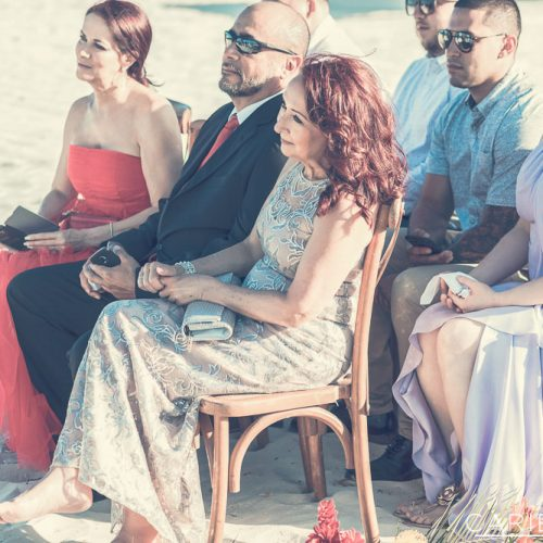 Guests at beach wedding ceremony at The Finest Playa Mujeres resort