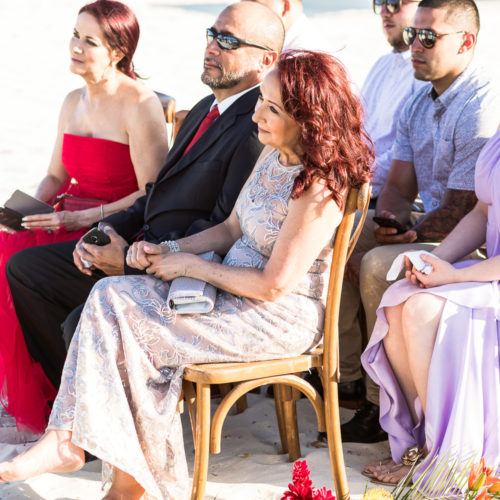 Guests at beach wedding ceremony.