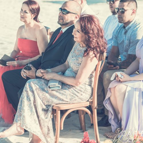 Parents of the bride at wedding on the beach at Finest Playa Mujeres, Cancun Mexico