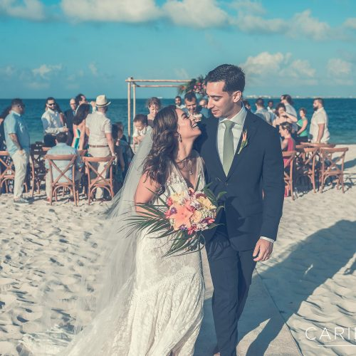 Bride and groom laughing after wedding ceremony at Finest Playa Mujeres, Cancun Mexico