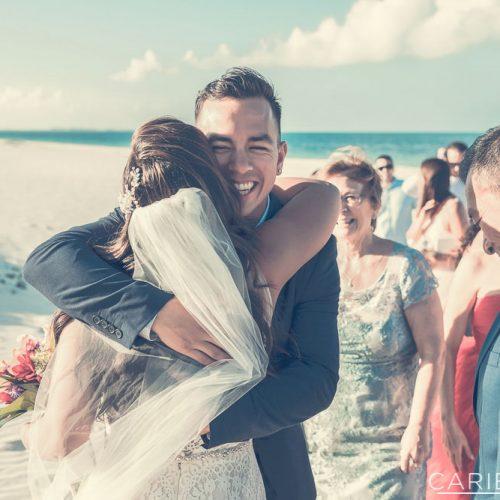 Bride hugging guest after wedding.