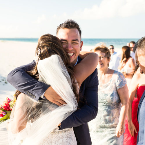 Bride hugging guest after wedding.