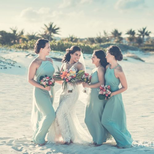 Bridesmaids having fun on beach after wedding atFinest Playa Mujeres Wedding, Cancun Mexico