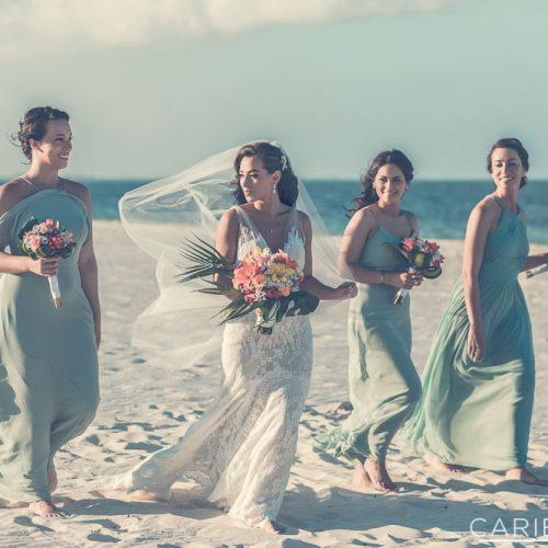 Bridesmaids walking on beach at The Finest Playa Mujeres resort