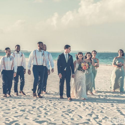 Bridal party walking down the beach at The Finest Playa Mujeres resort