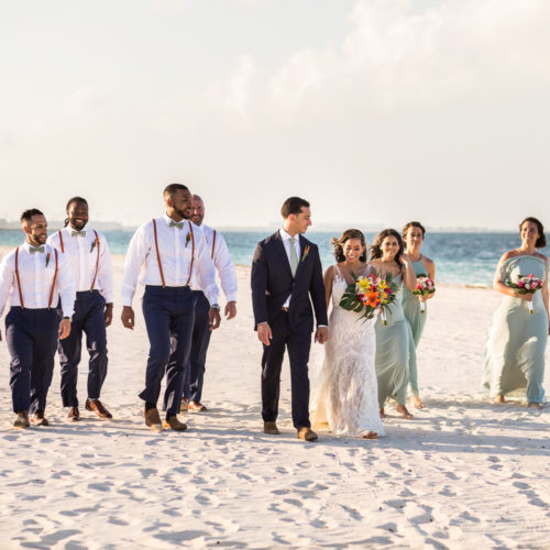 Bridal party walking on beach at Finest Playa Mujeres