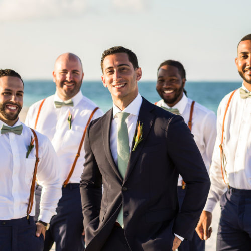 Groom and groomsmen on beach at Finest Playa Mujeres