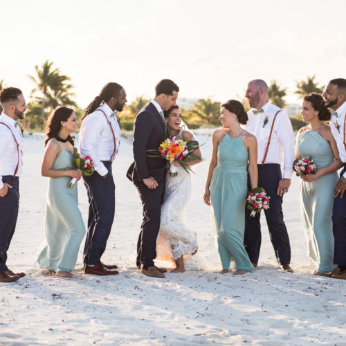 Bridal party having fun on beach at Finest Playa Mujeres