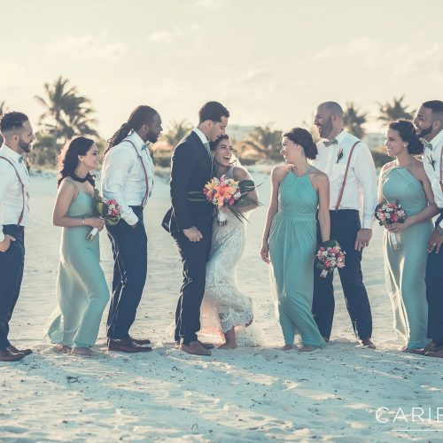 Fun bridal party portrait on beach at Finest Playa Mujeres, Cancun Mexico