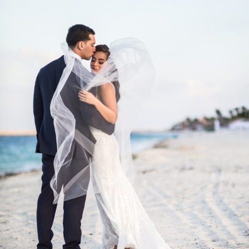 Bride and groom on beach at Finest Playa Mujeres