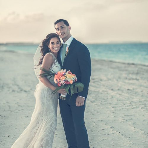Portrait of bride and groom on beach at The Finest Playa Mujeres resort