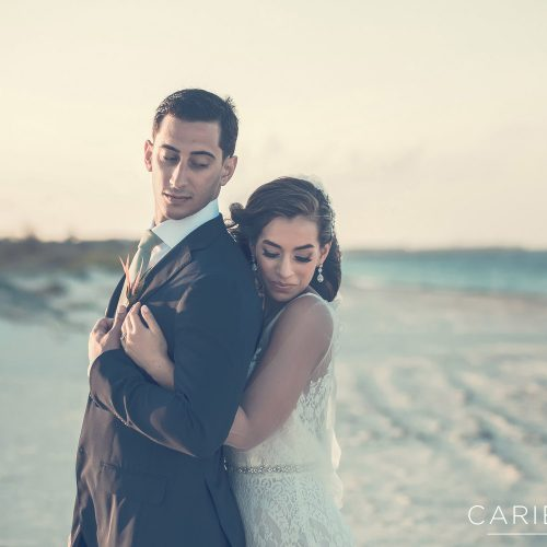 Bride hugging groom on beach at Finest Playa Mujeres, Cancun Mexico