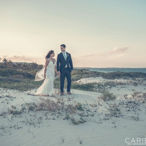 Bride and groom on dunes at The Finest Playa Mujeres resort
