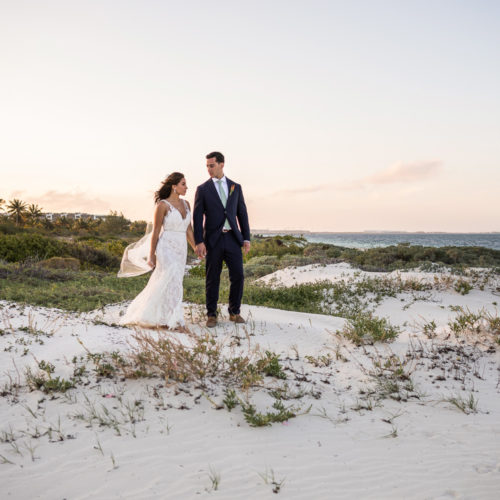 Bride and groom on sand dune at Finest Playa Mujeres