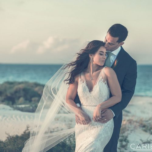 Bride and groom on beach at The Finest Playa Mujeres resort