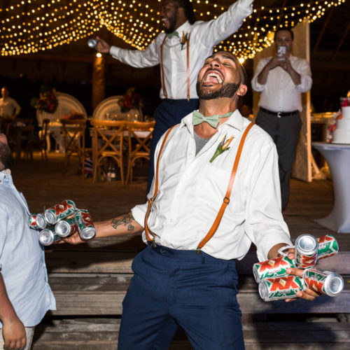 Guests dancing at wedding reception.