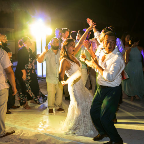 Guests dancing at wedding reception at Finest Playa Mujeres.