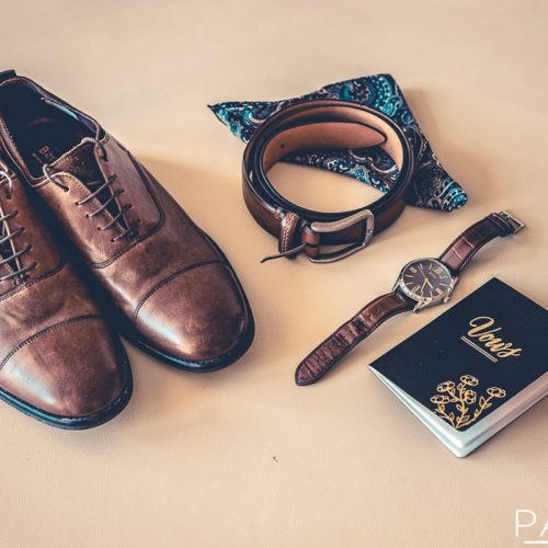 Details of grooms shoes and belt at wedding