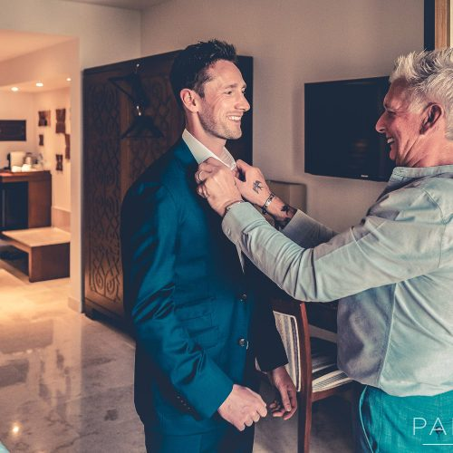 Groom with father getting ready at Secrets Playa Mujeres resort Cancun