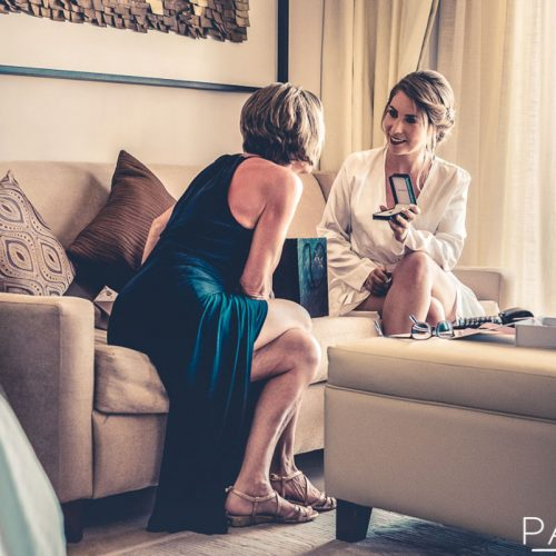 Bride and mother talking on sofa at Secrets Playa Mujeres in Cancun Mexico