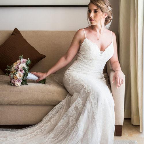 Bride on sofa before wedding.