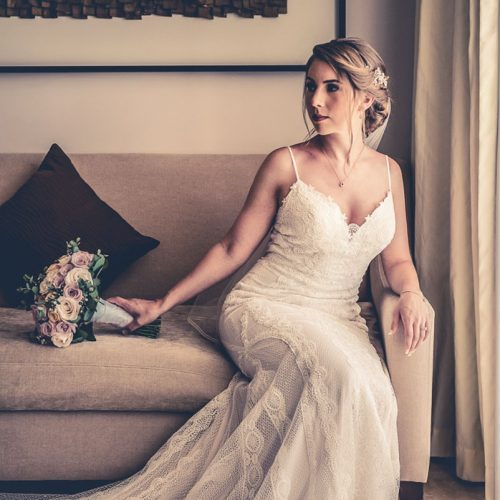 Portrait of bride before wedding on sofa at Secrets Playa Mujeres in Cancun Mexico