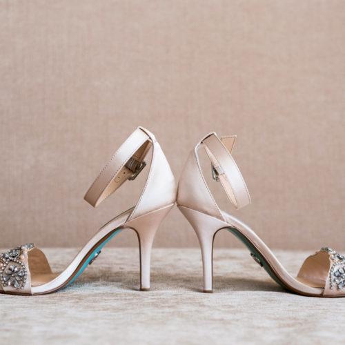 Detail photograph of brides shoes.