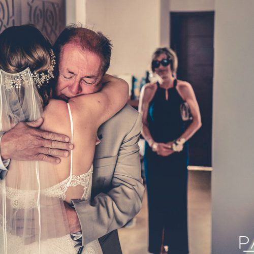 First look with bride and father of bride at Secrets Playa Mujeres in Cancun Mexi