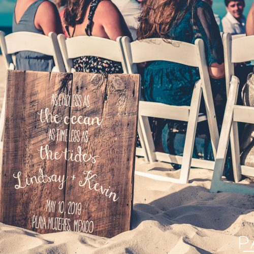 Detail of sign at beach wedding.