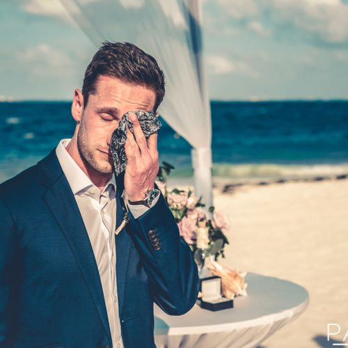 Groom crying as bride walks down aisle
