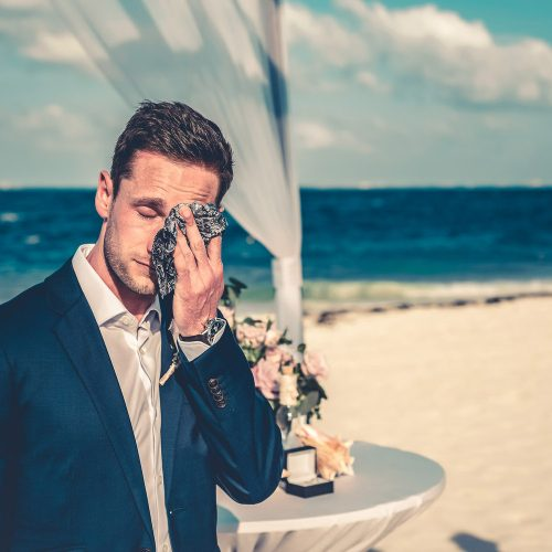 Groom wiping tears as bride walks down isle at Secrets Playa Mujeres, Cancun Mexico