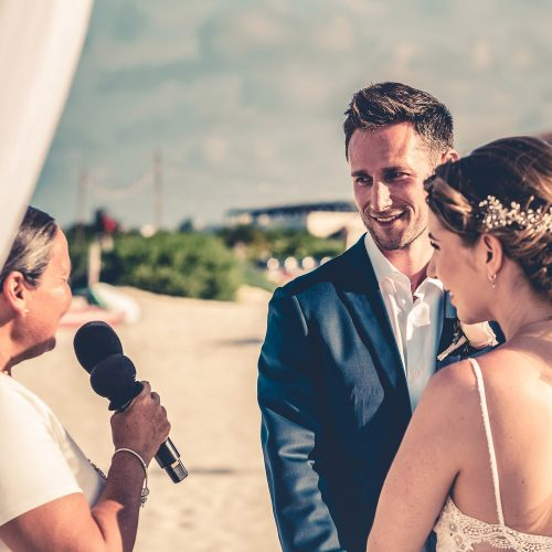 Bride and groom saying vows at beach wedding at Secrets Playa Mujeres, Cancun Mexico