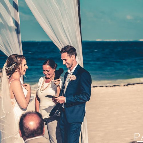 Bride and groom exchanging vows at Secrets Playa Mujeres in Cancun Mexico