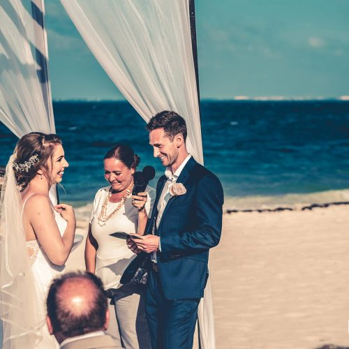 Bride and groom saying vows at wedding ceremony at Secrets Playa Mujeres, Cancun Mexico