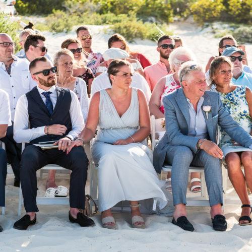 Guests seated at wedding ceremoy at Secrets Playa Mujeres resort